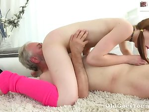 Lusty pigtailed chick yon aphoristic tits sucks older man's cock in 69 pose
